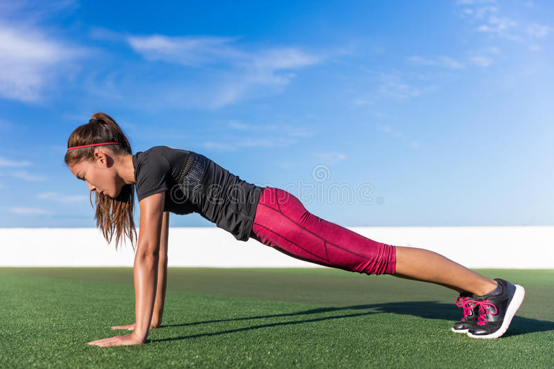Fitness woman planking yoga plank pose exercise. Fitness woman planking doing the bodyweight exercise for core strength training. Active girl practicing the yoga royalty free stock photography