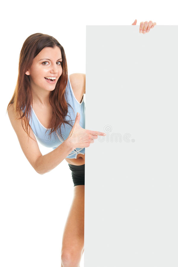 Fitness Woman Presenting Empty Placard Royalty Free Stock Photo