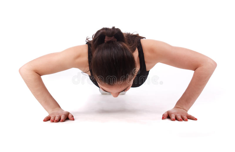 Fitness woman push ups. On the white background royalty free stock images
