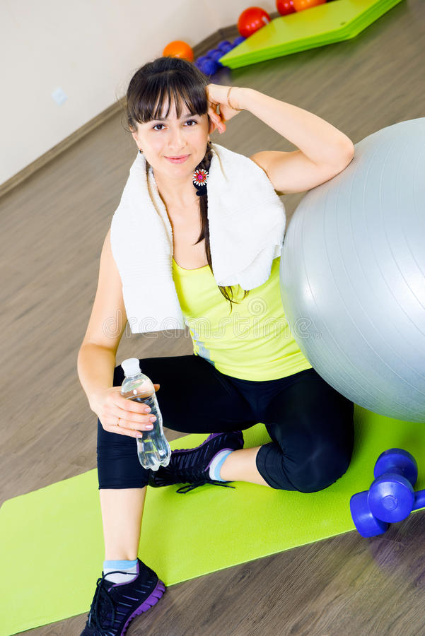 Fitness woman relax with water bottle stock photos