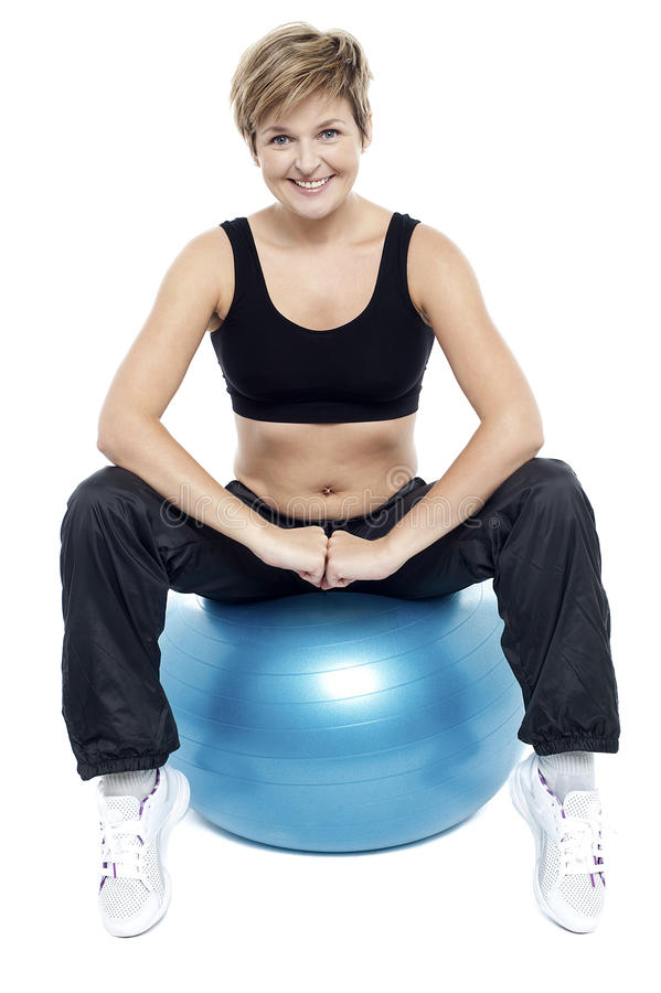 Fitness woman relaxing on exercise ball royalty free stock images