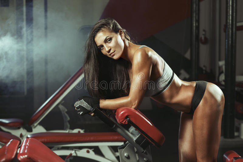 Fitness woman resting in the gym stock images