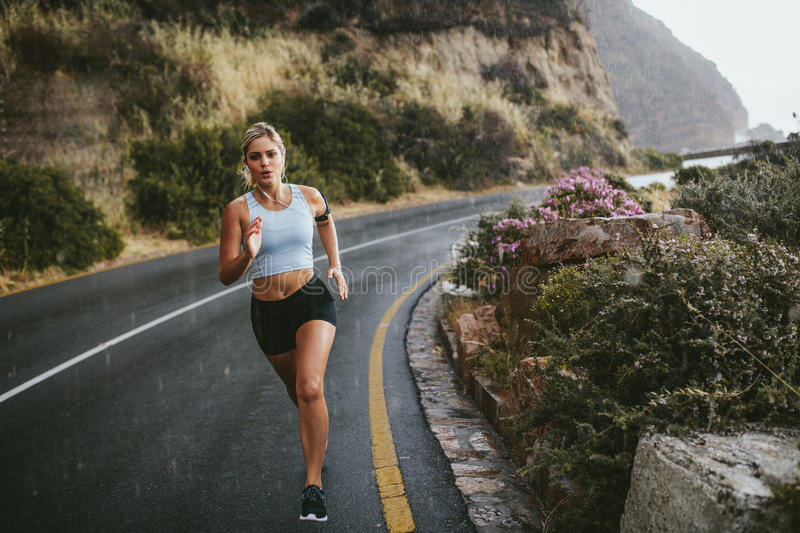 Download Fitness Woman Running On Countryside Highway Stock Image