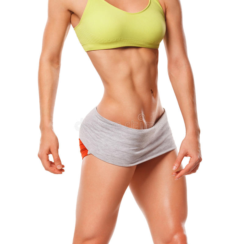 Fitness woman showing abs and flat belly. muscular woman royalty free stock image