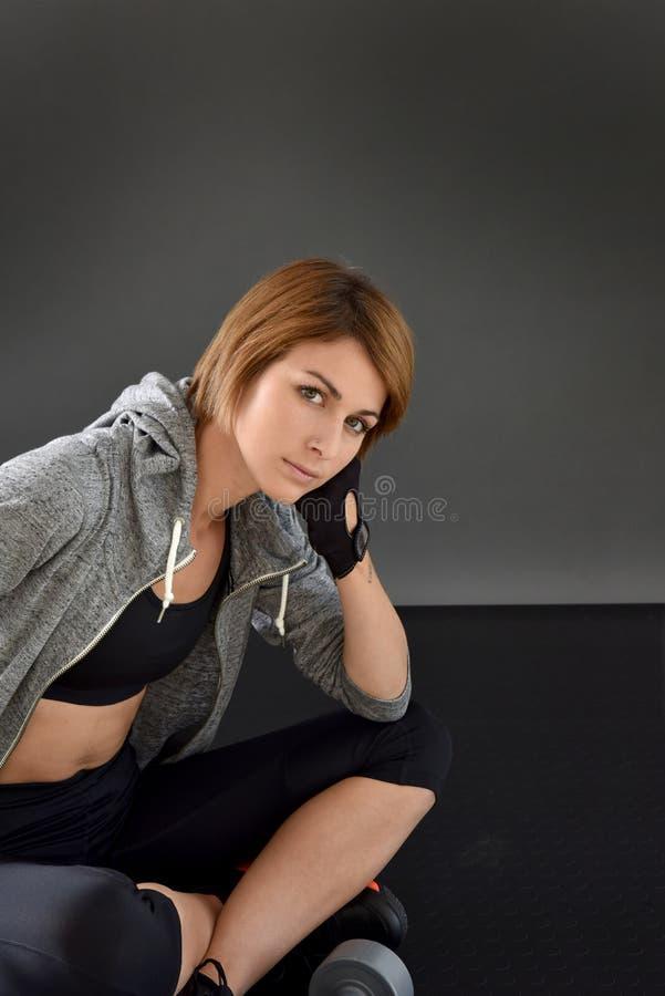 Fitness woman sitting on the floor stock photos