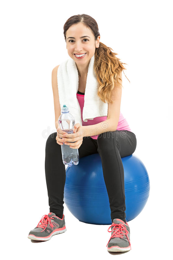 Fitness woman sitting on a pilates ball royalty free stock images