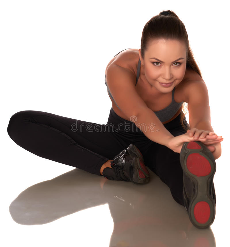 Fitness woman in sport style standing against isolated white background stock photography