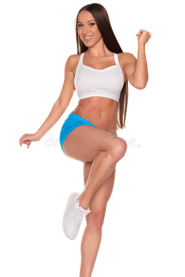 Fitness woman standing against isolated white background royalty free stock image
