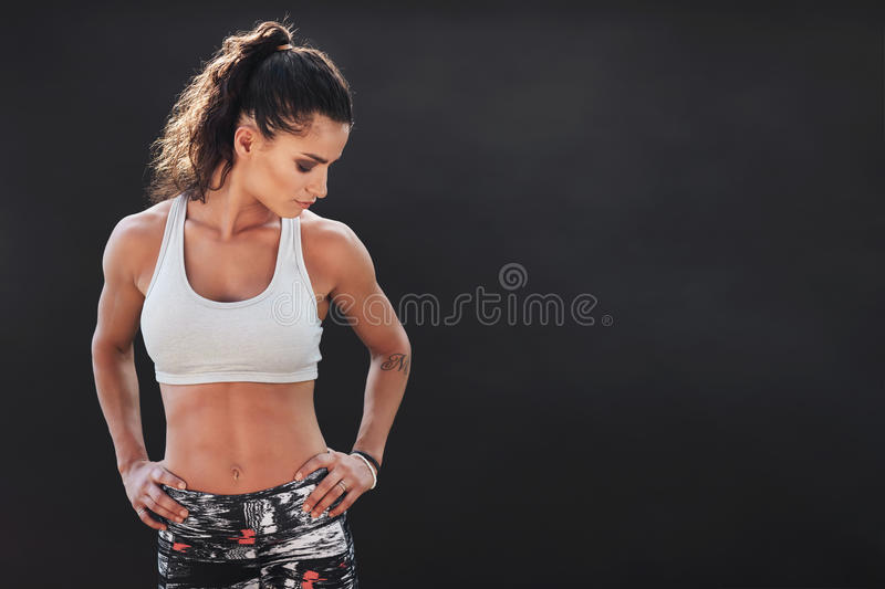 Fitness woman standing with her hands on hips stock image