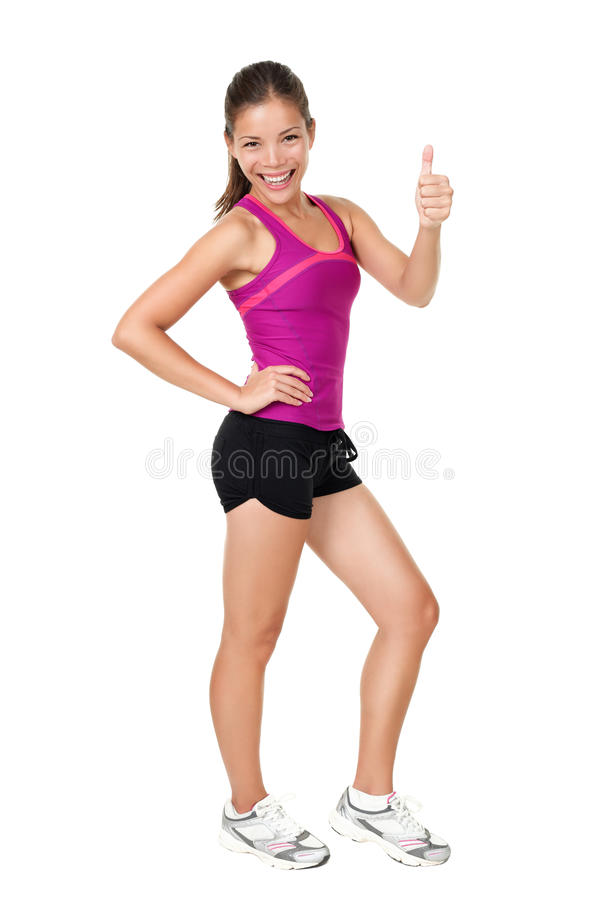 Fitness woman thumbs up success sign. Fitness woman showing thumbs up success sign standing in running fitness outfit in full body isolated on white background stock photography
