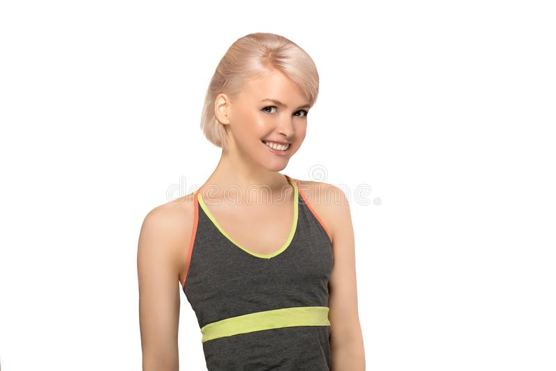Fitness woman on white background. Slim young fitness woman in sport style isolated on white background royalty free stock photography