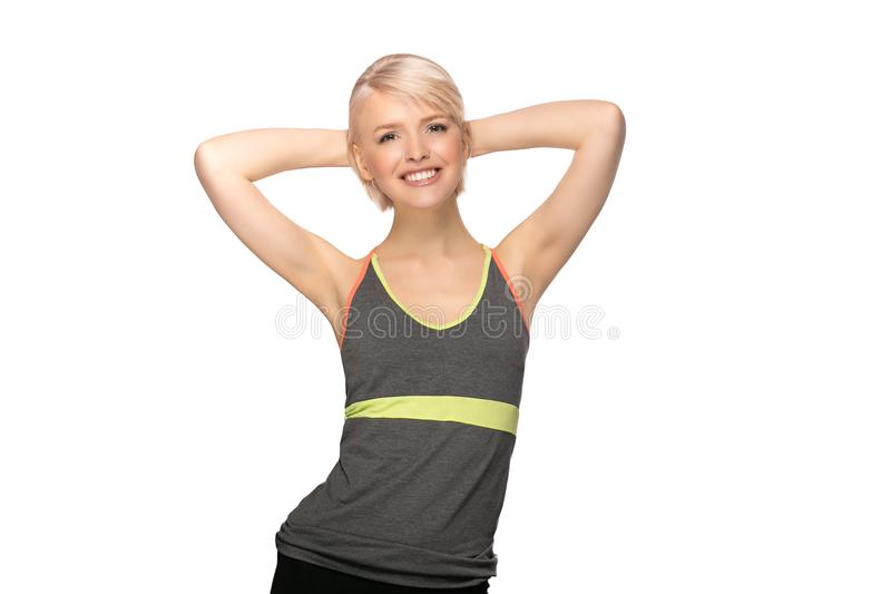 Fitness woman on white background. Slim young fitness woman in sport style isolated on white background stock photography
