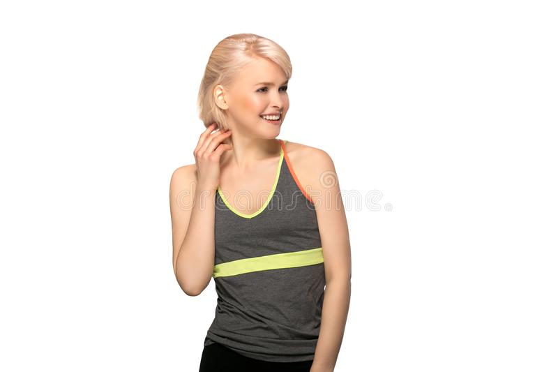 Fitness woman on white background. Slim young fitness woman in sport style isolated on white background royalty free stock photo