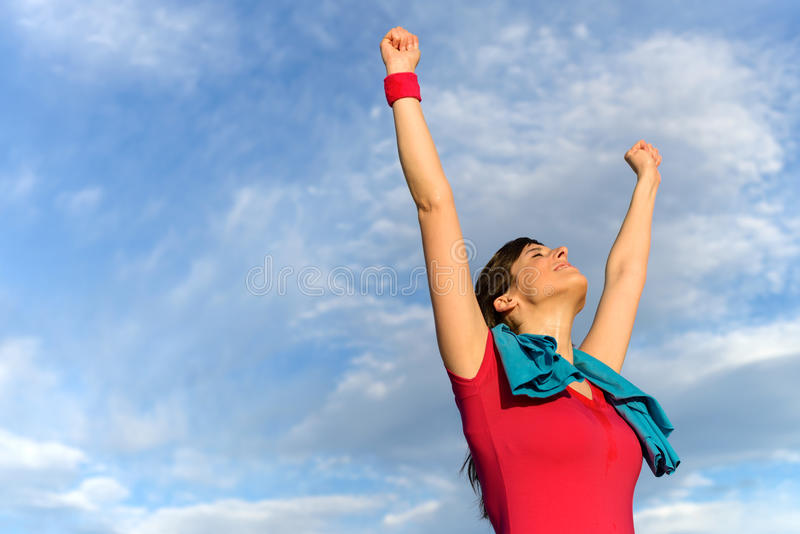Fitness woman win and success. Happy successful fitness woman raising arms and winning after exercising. Success in sport training concept royalty free stock photos