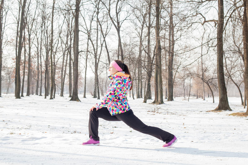 Fitness Woman Winter Activity. Fitness young woman exercise outdoor, winter season healthy activity royalty free stock photo