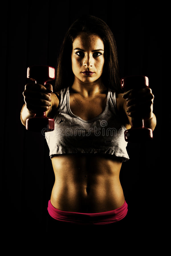 Fitness woman working out with dumbbells stock image