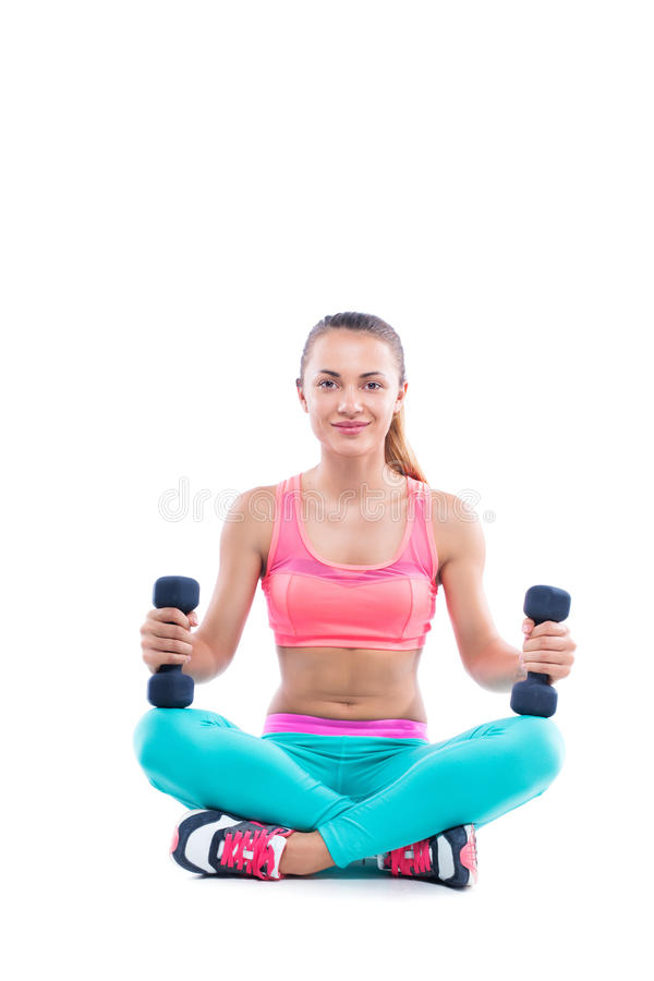 Fitness woman working out with dumbblles, isolated on white stock photos