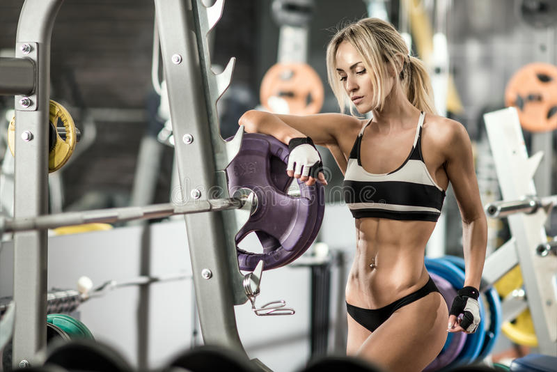 Fitness woman. Young fitness woman in gym, horizontal photo royalty free stock photo