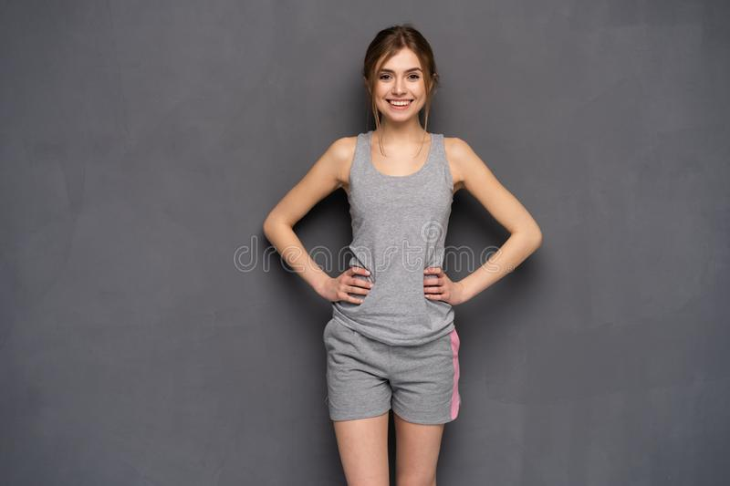 Fitness woman. Young sporty Caucasian female model isolated on gray background. Fitness woman. Young sporty Caucasian female model isolated on gray background stock photography