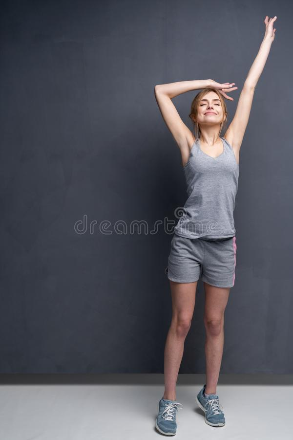 Fitness woman. Young sporty Caucasian female model isolated on gray background in full body. Fitness woman. Young sporty Caucasian female model isolated on gray royalty free stock photo