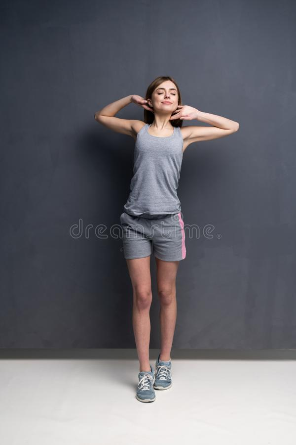 Fitness woman. Young sporty Caucasian female model isolated on gray background in full body. Fitness woman. Young sporty Caucasian female model isolated on gray stock images