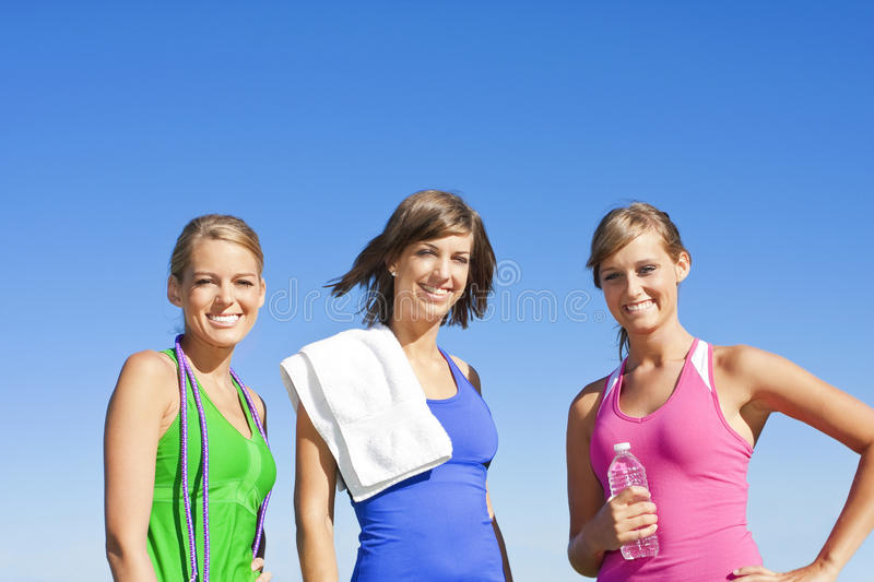 Fitness Women. Three Healthy, attractive women just before starting their fitness workout royalty free stock image