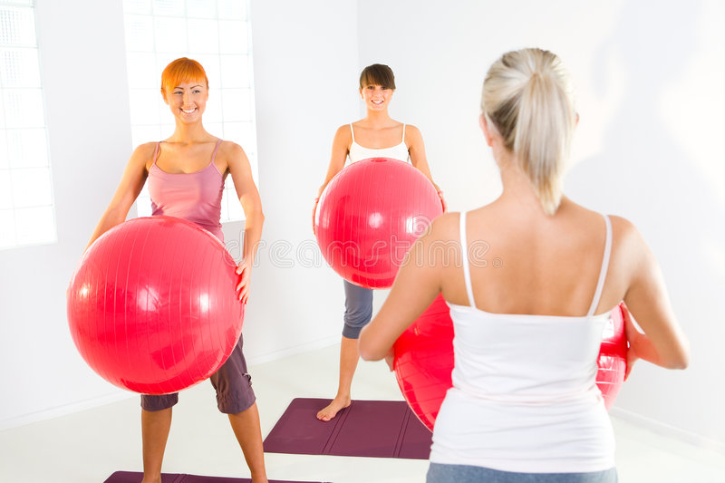 Fitness women. Group of women doing fitness exercise with big ball royalty free stock photography