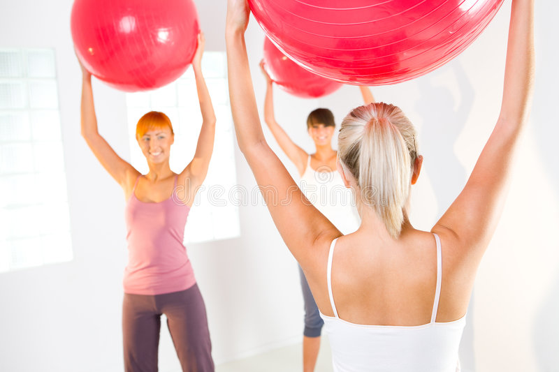 Fitness women. Group of women doing fitness exercise with big ball stock images