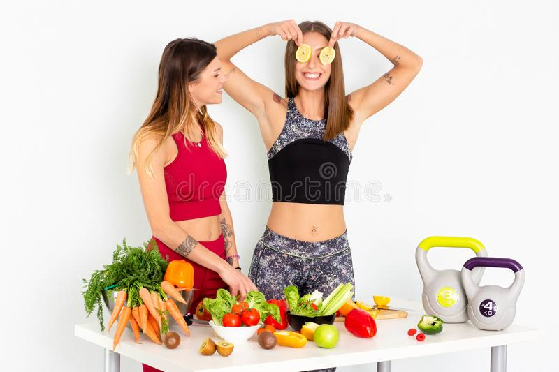 Fitness Women  with Vegetables Stock Images And Stock Footage. Sport fitness women leggings,Young beautiful girl with with sports top and tights with fruits and stock image