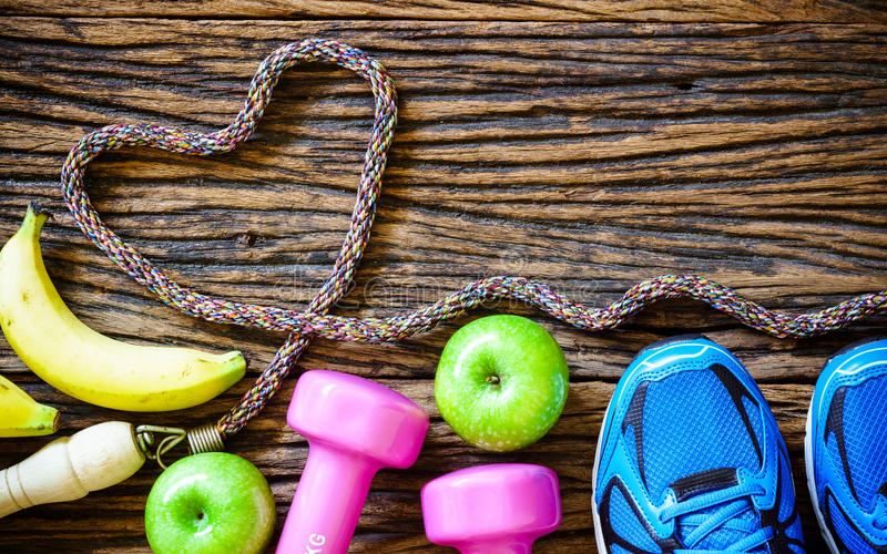 Fitness workout love , healthy fruit eating concept - Top view. Fitness workout love and healthy fruit eating concept - Top view of bananas, green apples, sport stock image