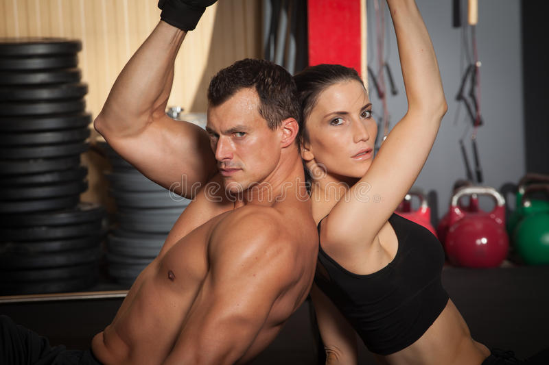 Download Fitness Workout Man And Woman In A Gym Stock Image