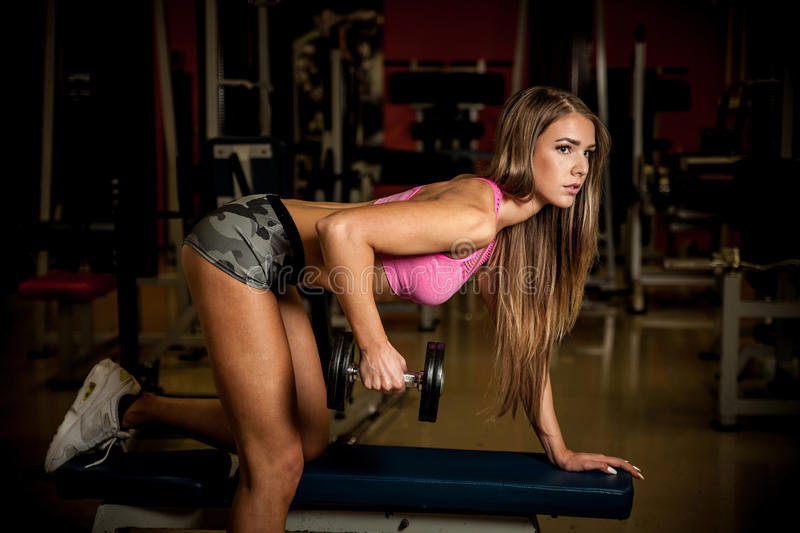 Fitness workout - Popular beautiful young woman workout stock photo