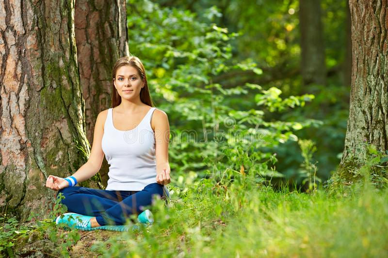 Fitness yoga exercise in wood. Young woman healthy lifestyle portrait royalty free stock photography