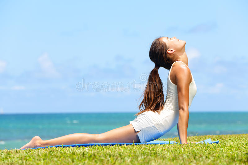 Fitness yoga woman stretching in cobra pose stock photos
