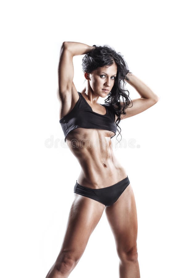 Fitness young brunette woman posing over white isolated. Fitness young brunette woman posing in black wear isolated in studio over white isolated stock photos