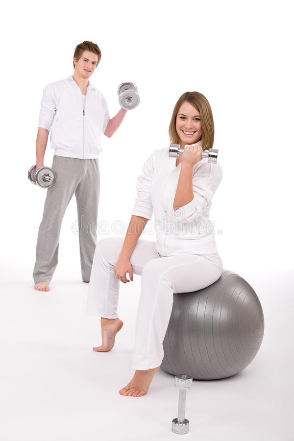 Fitness - Young couple exercise with weights royalty free stock images