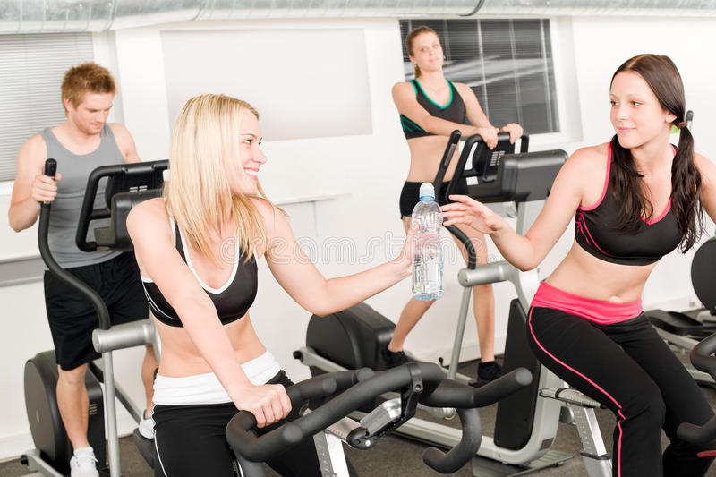Fitness young girl on gym bike royalty free stock photo