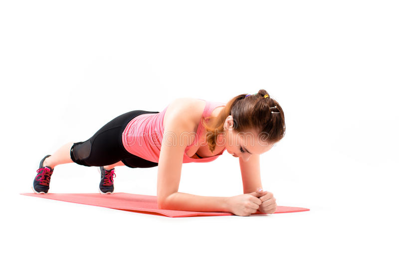 Fitness young woman doing Exercise plank, isolated on white background stock photography