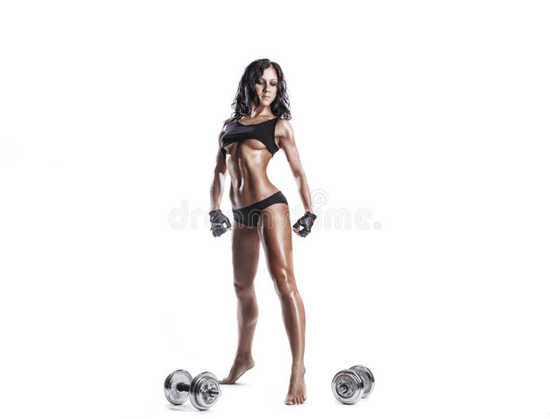 Fitness young woman resting after exercise with dumbbells isolated royalty free stock photo
