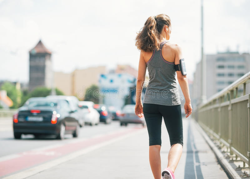 Fitness young woman walking in the city royalty free stock photos