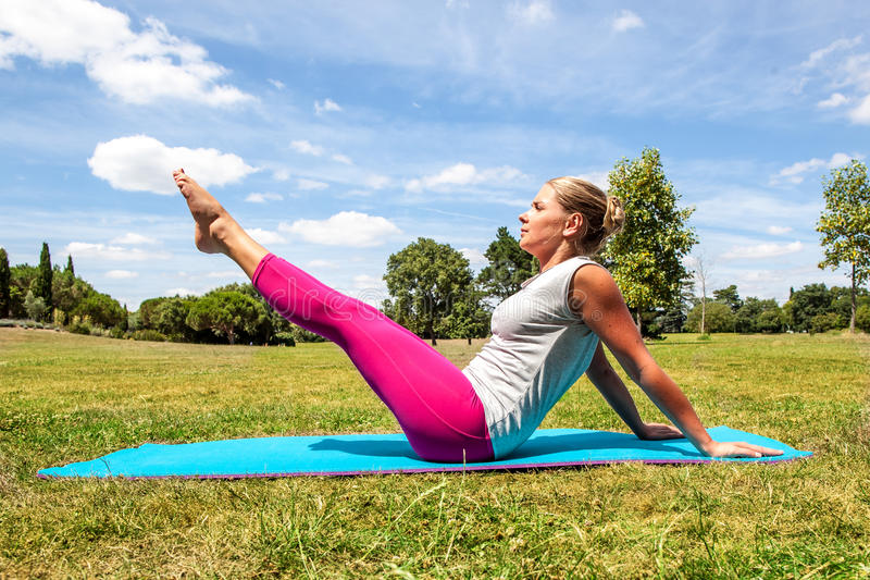 Fitness for young woman working out to keep fit outside stock image