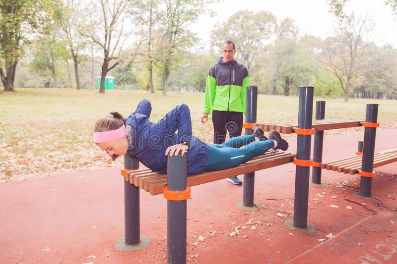 Sporty Girl Doing Push-Ups Outdoor Workout stock images