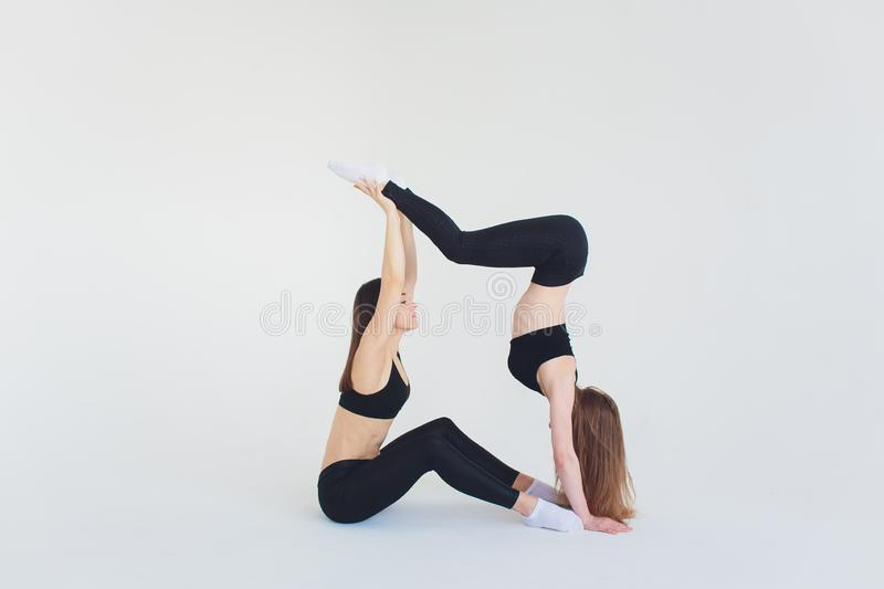 Fitogirl with incredible body posing in studio after training with some relax. Fitogirl with incredible body posing in studio after training with some relax stock image