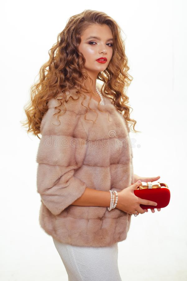 Fits her just right. Pretty woman in fashionable fur coat. Fashion model wear luxurious fur. Young woman wear elegant royalty free stock photo