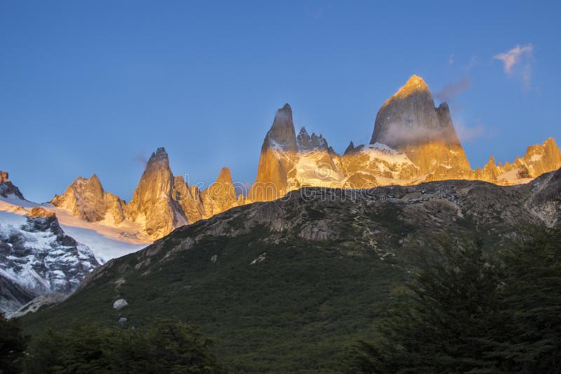 Fitz Roy amazing views inside the Argentina Patagonia with an awesome sunrise filling the rock towers with an increcible orange co royalty free stock image