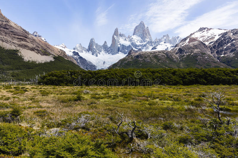 Fitz Roy with a field and surrounding mountains royalty free stock images