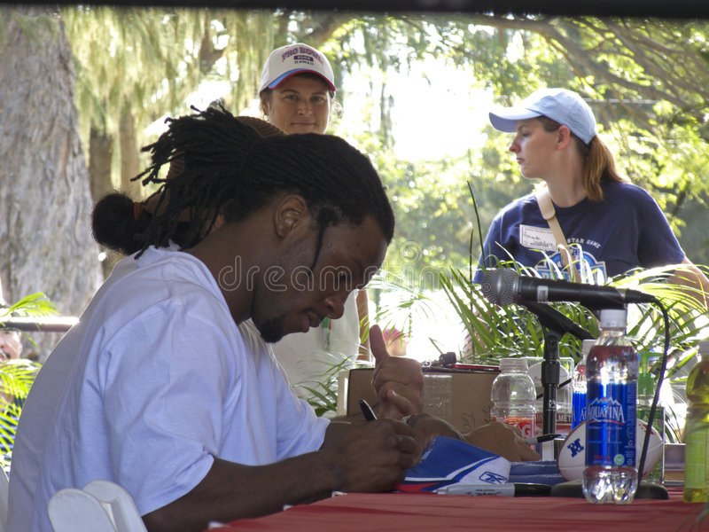 Fitzgerald, Larry. Larry Fitzgerald, the Arizona Cardinal Receiver voted 2009 Pro Bowl MVP after scoring two touchdowns, autographing a Pro Bowl souvenir royalty free stock photos