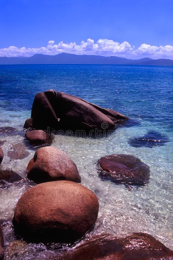 Fitzroy Island Beach Australia. Light waves wash in among huge boulders on Nudey Beach of Fitzroy Island, Australia royalty free stock image