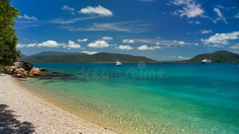 Fitzroy Island near Cairns Australia, beach, boat. Fitzroy Island near Cairns Australia, View of the beach and boats and small Island. Beautiful clear water stock photos