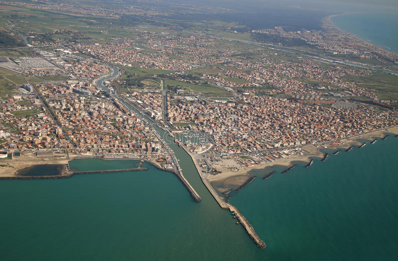 Fiumicino, near Roma, Lazio, Italy from airplane window. Aerial view of the Tyrrhenian coastline and Fiumicino town, near Roma, Lazio, Italy stock photography